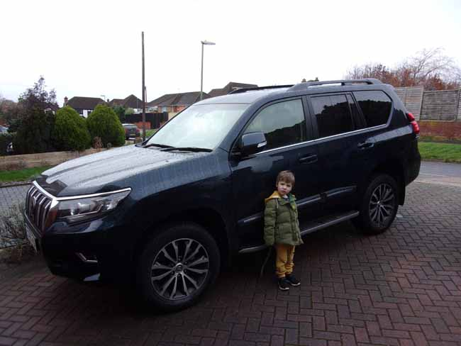 Henry Saunders stands beside the Toyota Land Cruiser Invincible  lr